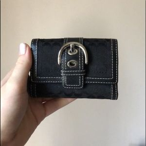 Black leather Coach trifold wallet